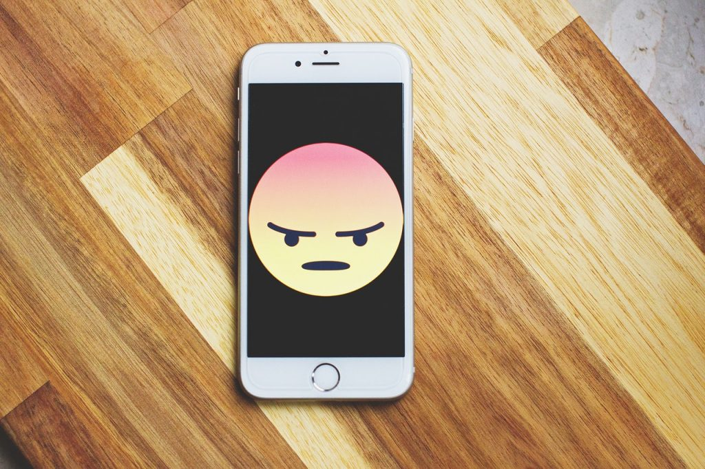 phone with angry emoji